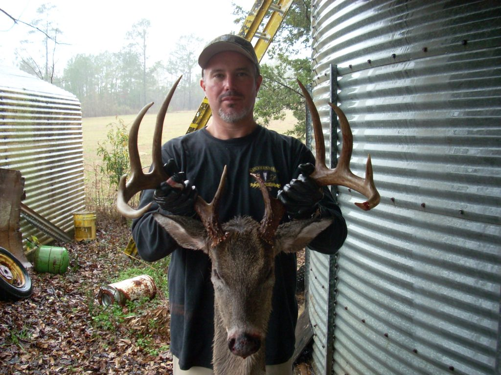Mike Cox of Chambers County, Alabama harvested this 151 in. 10 point while using DEER HERE Acorn Attractant.  Mike states that the buck was following a doe, and she was licking the DEER HERE from leaves and twigs, which had been sprayed earlier as he entered his stand.
